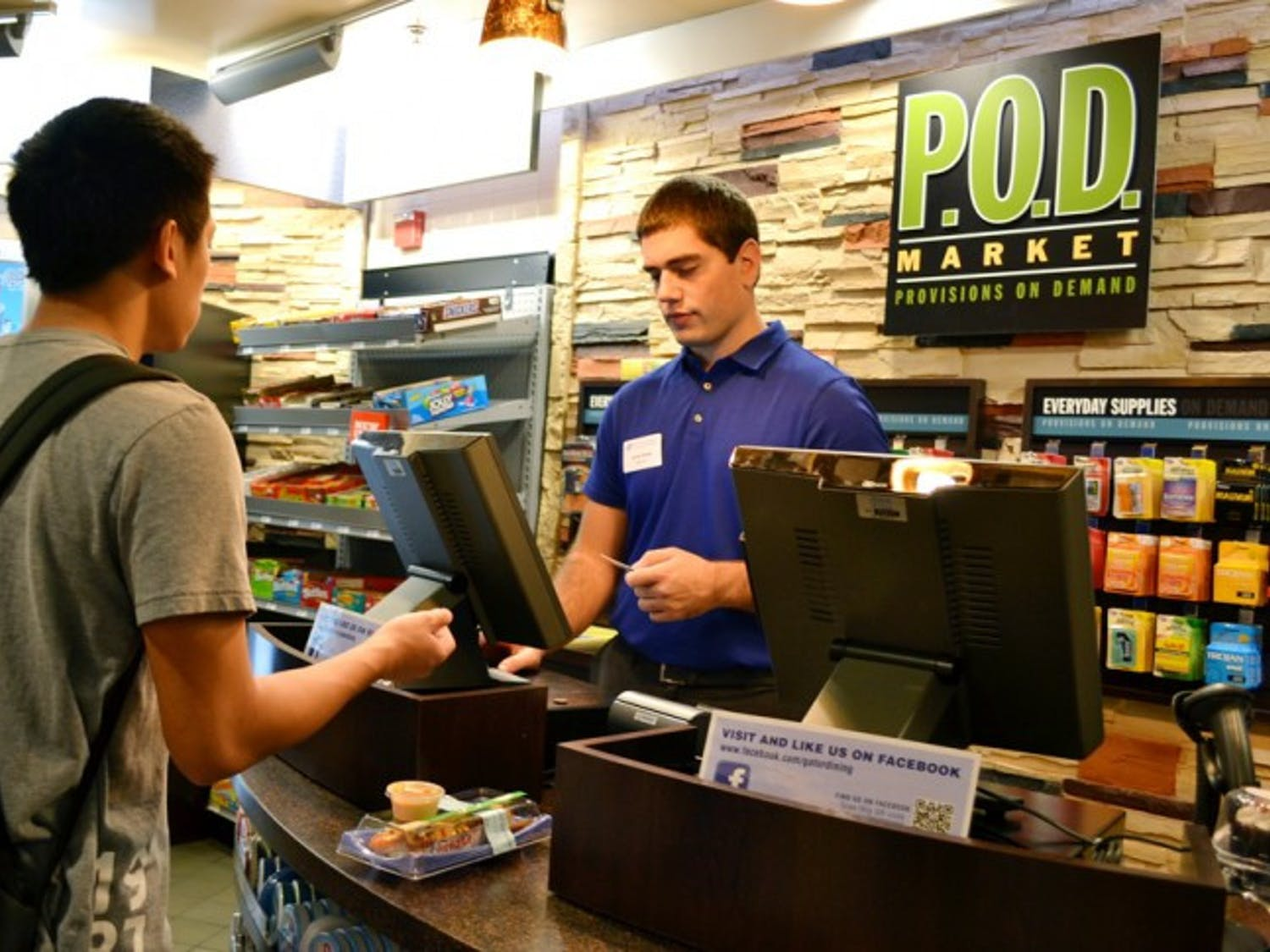 Danny Nguyen, a 19-year-old biology sophomore, bought a rainbow roll from Jason Reddy, a 22-year-old family, youth and community sciences UF alumnus. The P.O.D. Market opened Monday in the Hub.