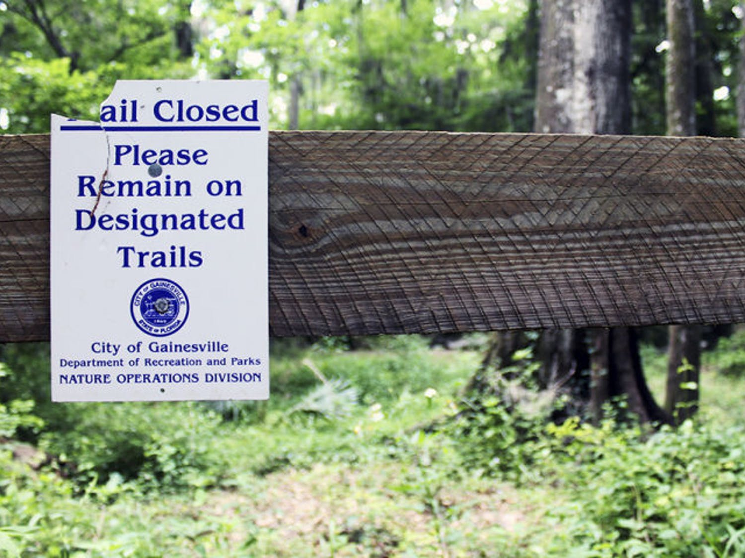 A sign at Loblolly Woods Nature Park in Gainesville warns of closures to the boardwalk Monday afternoon.