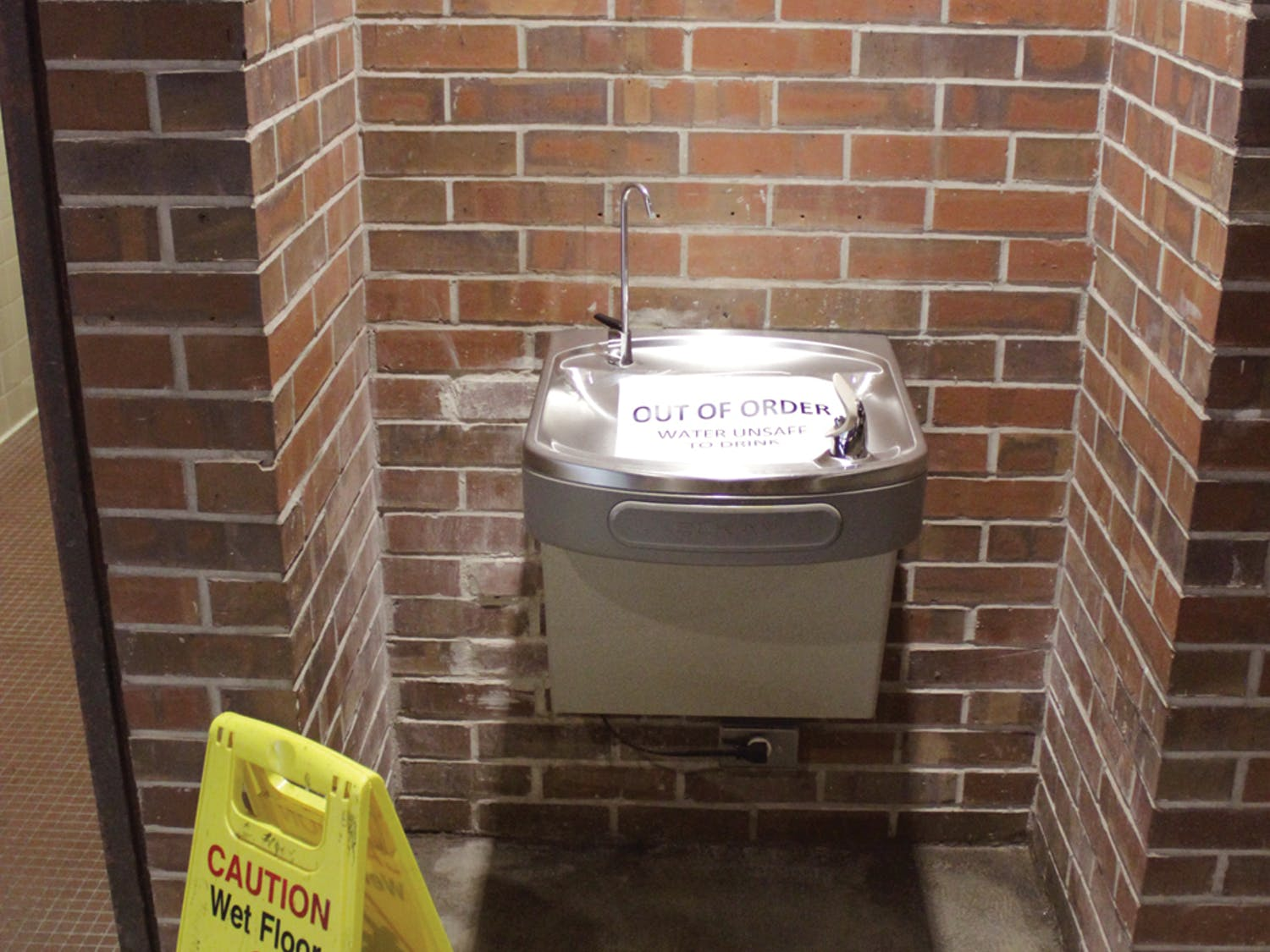 A water fountain in the east wing of Norman Hall is marked as out of order on Sept.17, 2015. Water in some parts of the building was deemed unsafe to drink.