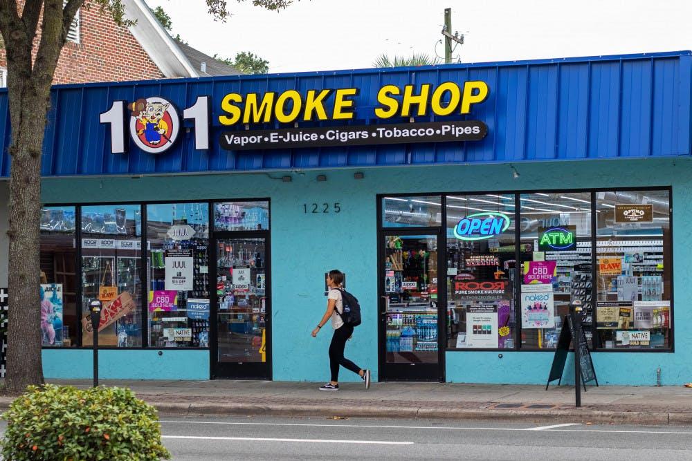 "<p><span id=""docs-internal-guid-fbd443e6-7fff-5c46-9246-d37ca1f73691""><span>A woman walks by 101 Smoke Shop on SW Archer Road.</span></span></p>"