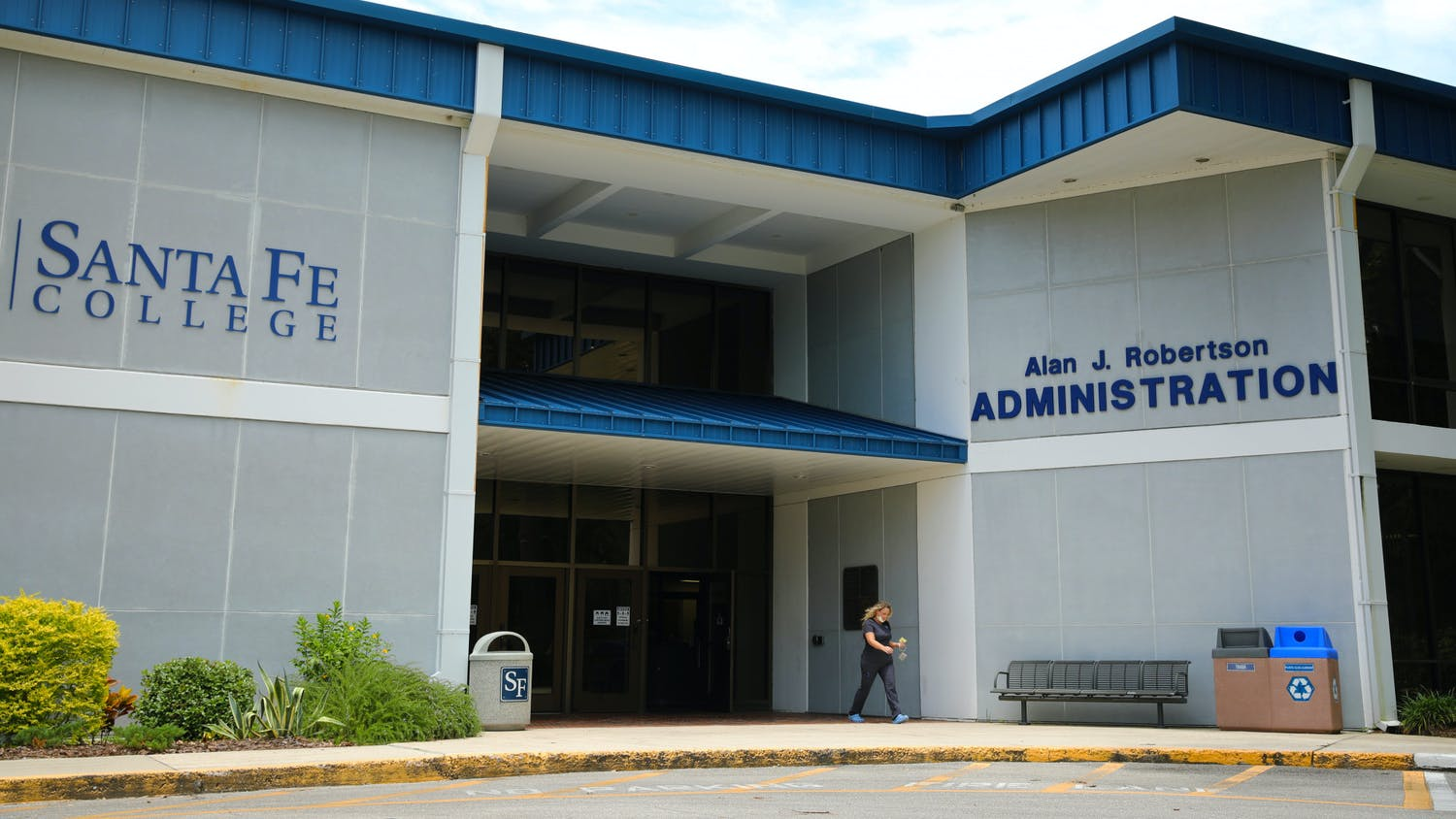 Cristie Anderson, 38, a nursing student at Santa Fe College, passes by the Alan J. Robertson Administration building on Friday, June 18, 2021.