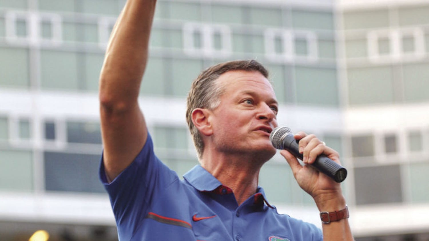 Scott Stricklin, 47, the UF athletic director, points to the audience in attendance, saying that without the support of the UF Student Body, the Gators' athletic success wouldn't be possible.
