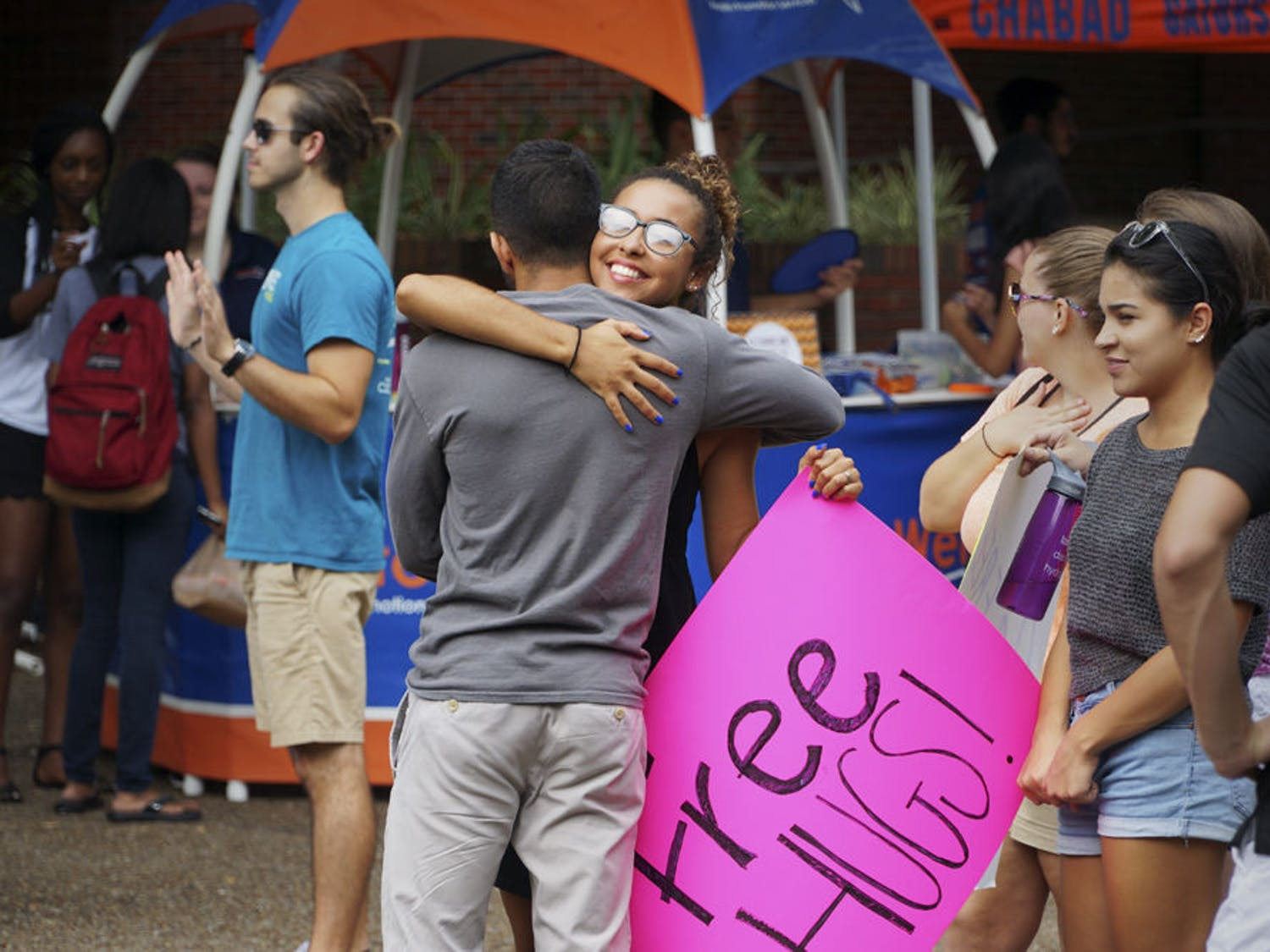 "Aleena Martin (right), a 19-year-old UF family youth and community sciences sophomore, gives a ""Free Hug"" to Tanuj Amalean, a 19-year-old UF mechanical engineering sophomore, in Turlington Plaza Sept. 8, 2015. Martin was with her Intro to Family, Youth and Community Sciences class giving free hugs as part of an extra-credit assignment. ""We are encouraged to give healing through hugs,"" she said."