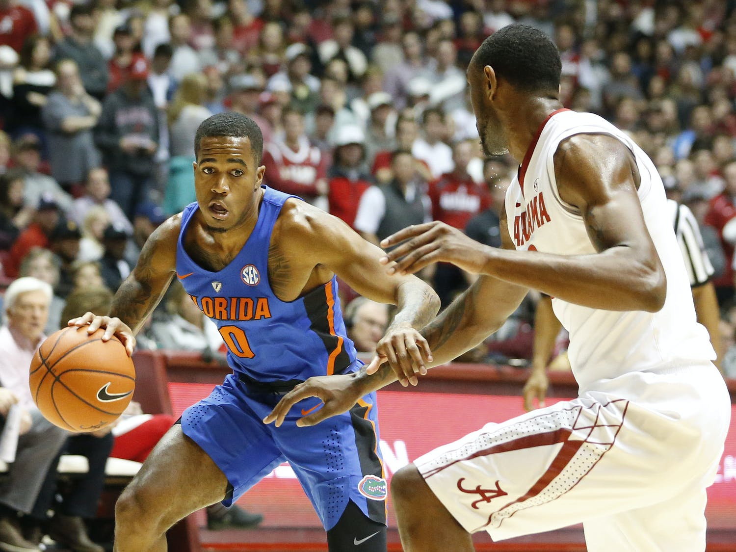 Florida guard Kasey Hill drives the ball against Alabama forward Jimmie Taylor during the first half of an NCAA college basketball game, Tuesday, Jan. 10, 2017, in Tuscaloosa, Ala. (AP Photo/Brynn Anderson)