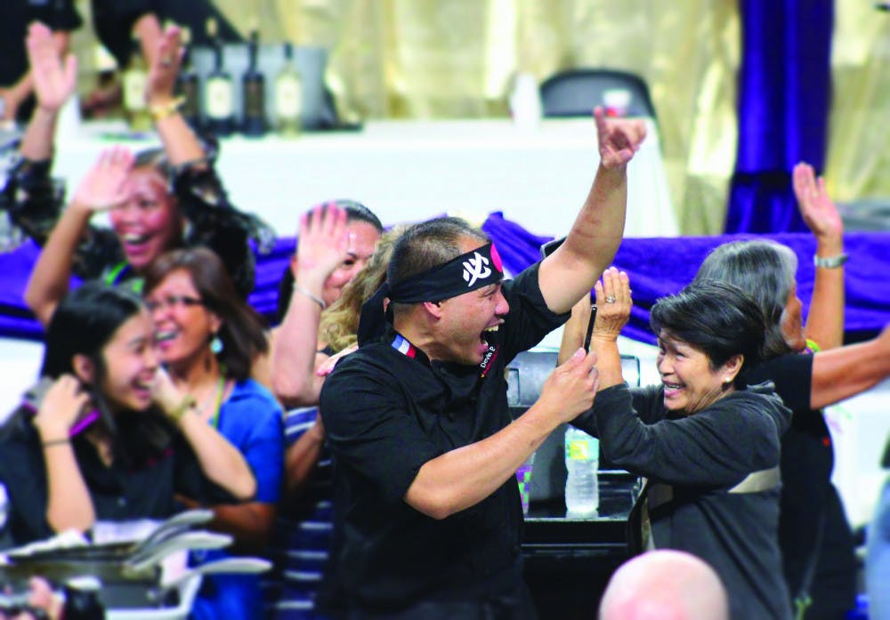 """<p><span id=""""docs-internal-guid-a697e771-ce35-ed17-a6c1-b638dea14e62"""">Chef Nester Espartero of Volcanic Sushi + Sake celebrates his team's Iron Chef victory at Tastes of Greater Gainesville 2018.</span></p>"""