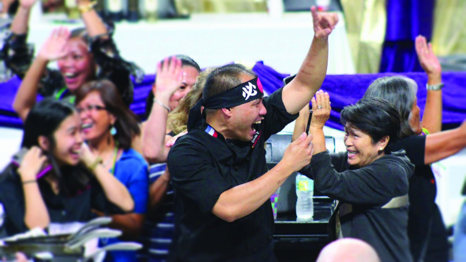 Chef Nester Espartero of Volcanic Sushi + Sake celebrates his team's Iron Chef victory at Tastes of Greater Gainesville 2018.