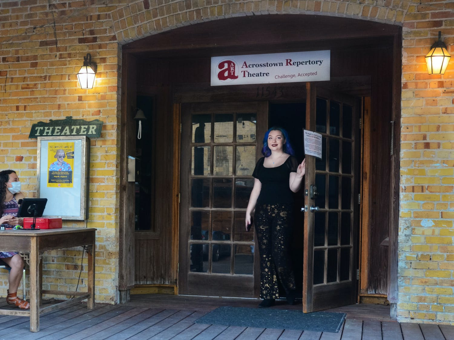 """Miranda Campos, 20, the stage director at the Acrosstown Repertory Theatre, steps outside before a showing of """"The Complete Works of WIlliam Shakespeare"""" on Saturday, July 24, 2021. The show runs from July 22 to August 8 at the theater's 619 S Main Street location; the compilation production transforms 37 historical plays, tragedies and comedies into a single 90 minute show."""