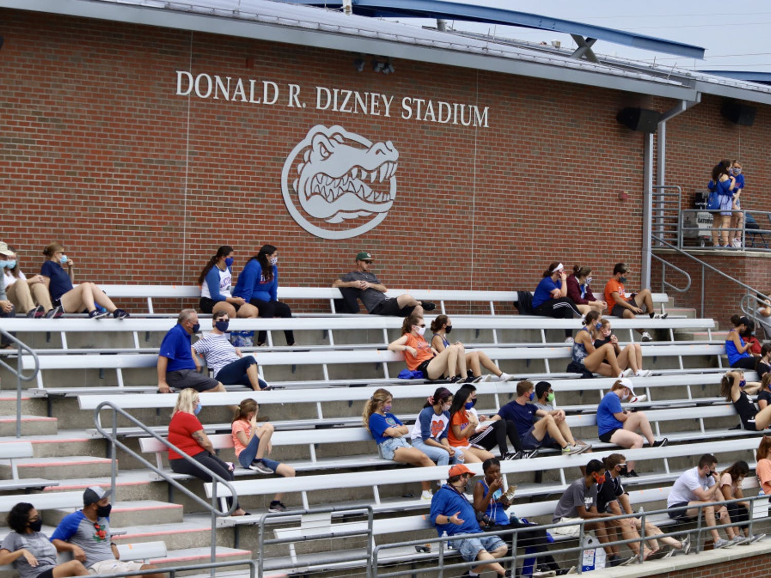 Groups of fans social distance and wear masks at Florida's first home game of the season. Friday is their final game in Donald R. Dizney Stadium this season, and theGators look to recover their conference record with a win over the Volunteers.