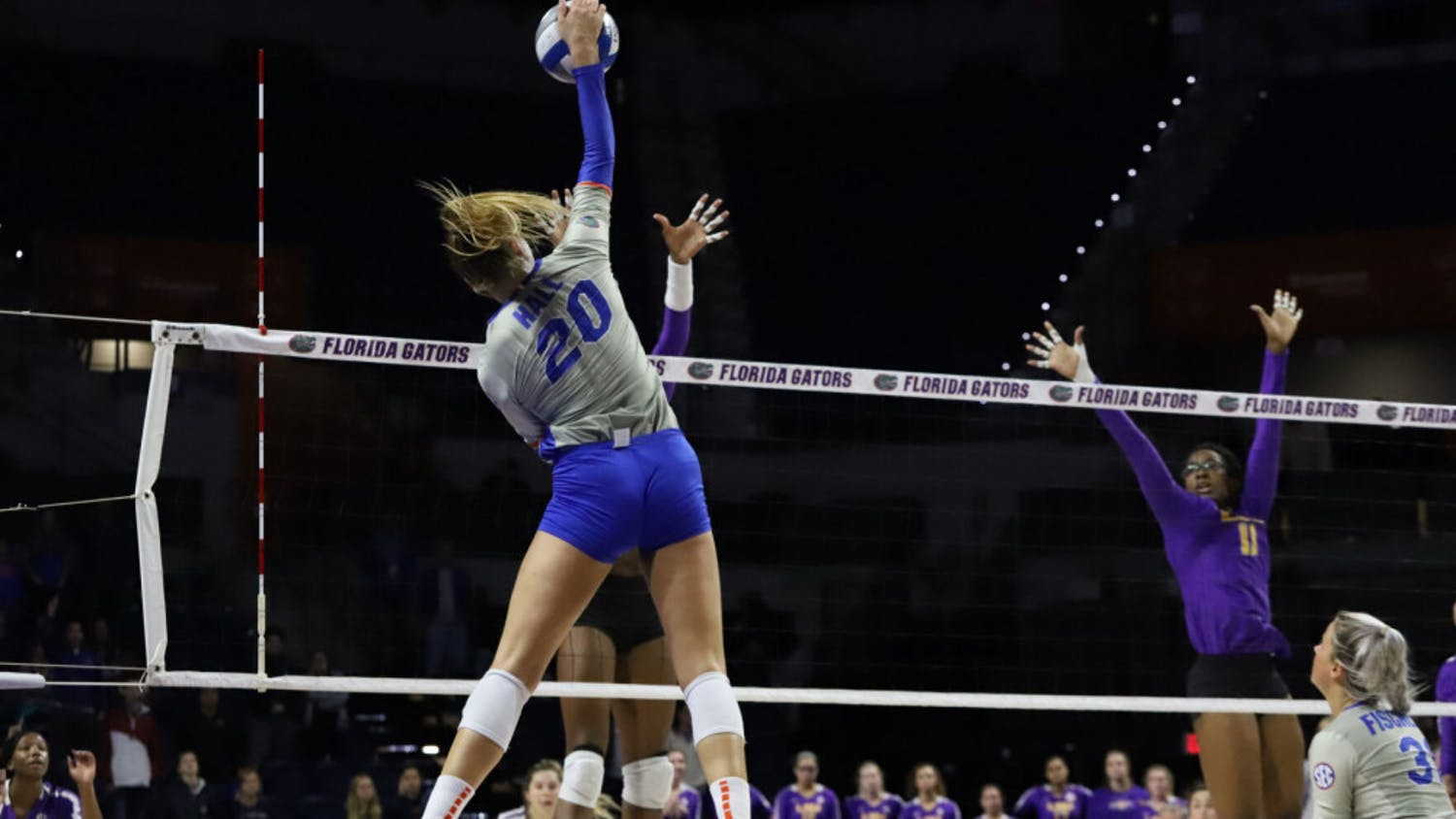 Florida's Thayer Hall spikes a ball against LSU in 2019. Hall and the Gators won their season-opening match against San Francisco Friday night in part of the Hornet Invitational.