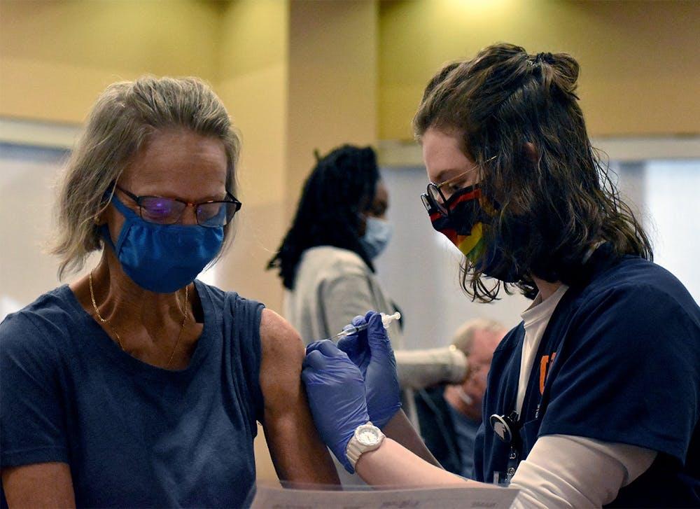 A UF Health nurse prepares to administer a COVID-19 vaccine Friday, Feb.5, 2021.