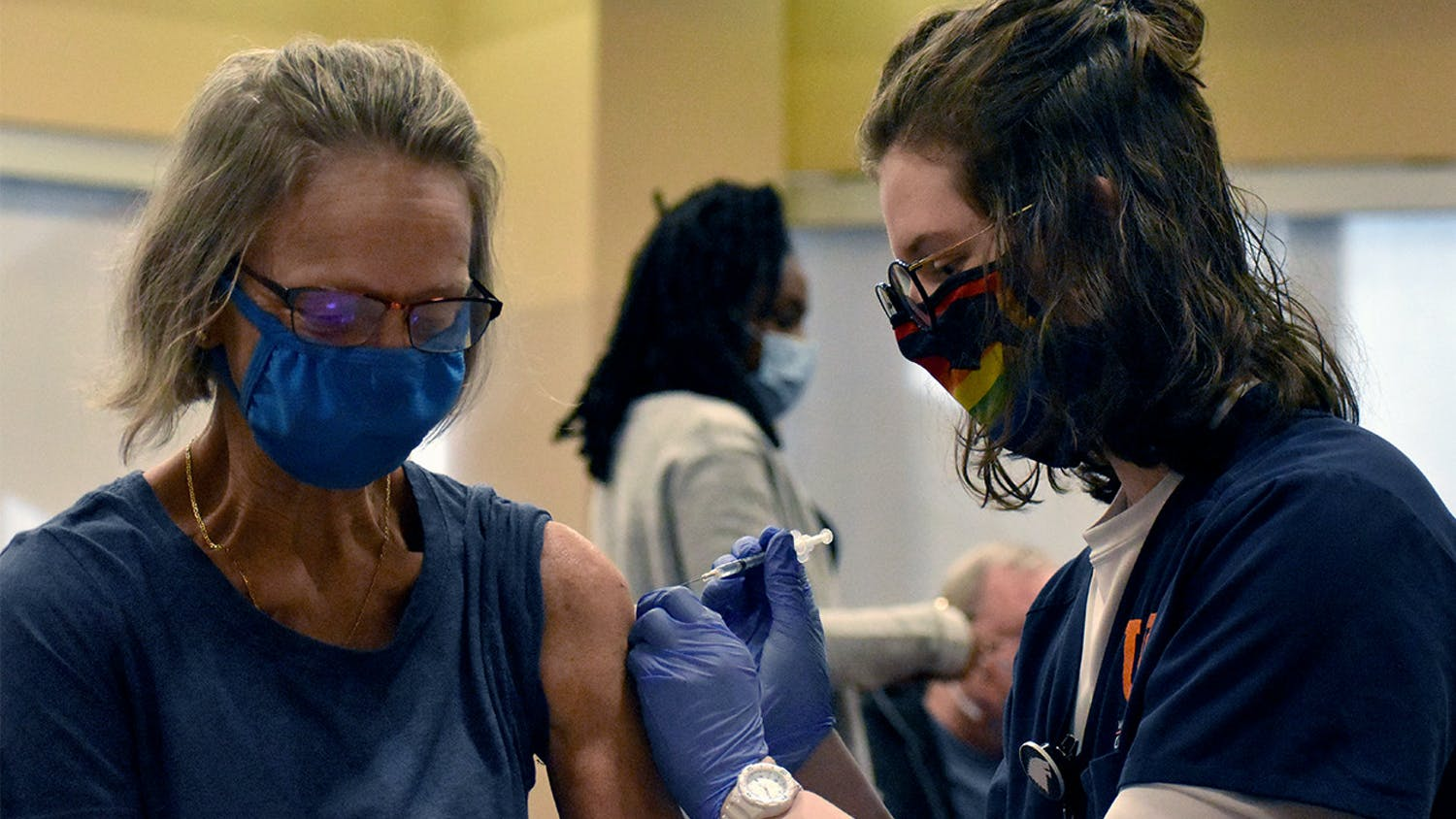 A UF Health nurse prepares to administer a COVID-19 vaccine Friday, Feb.5, 2021.