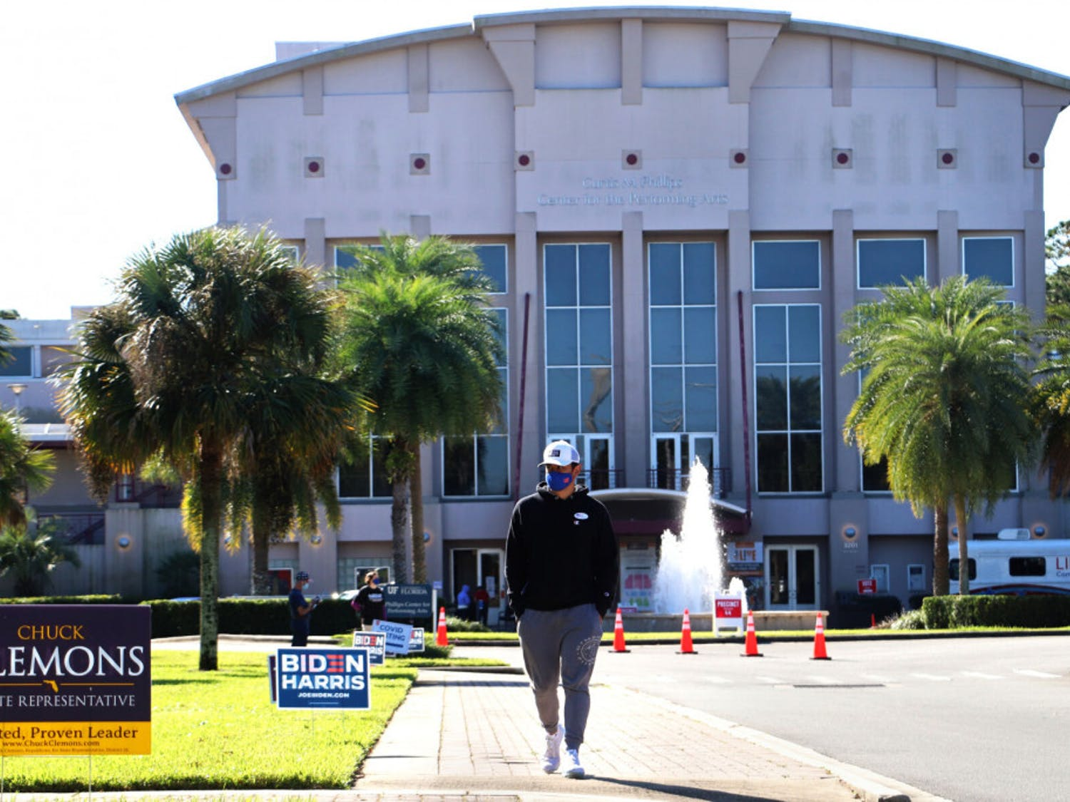 Dominic Bouton, 20, a UF applied physiology and kinesiology junior, leaves the Curtis M. Phillips Center for the Performing Arts after voting on Tuesday, Nov. 3, 2020. (Lauren Witte/Alligator Staff)