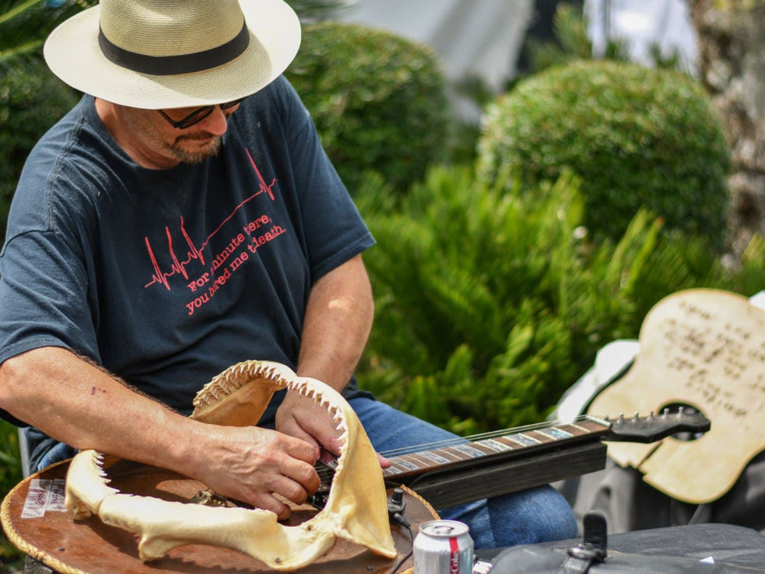 James Floyd, a guitar luthier from Pensacola, Florida, plays a guitar Sunday that he handcrafted from the jaws of a nine-foot shark. Floyd exhibited his collection of unique handmade guitars at the 50th Annual Spring Arts Festival put on by Santa Fe College. The two-day festival had live music, food, paintings, sculptures and many other forms of art.