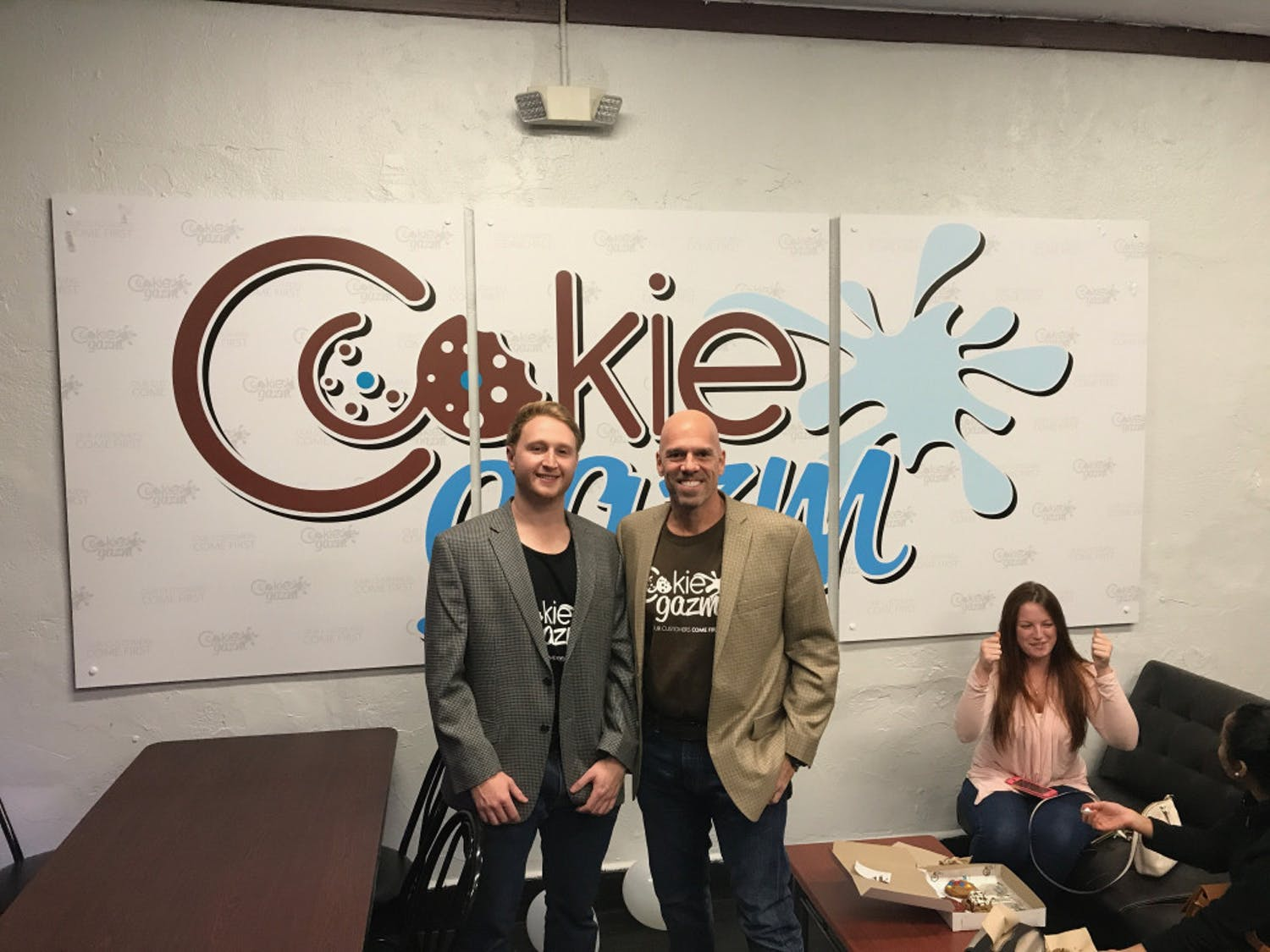 Aaron Seemann, owner, and Jose Benacerraf, partner and investor, celebrate the opening of Cookiegazm's new store located in downtown Gainesville.
