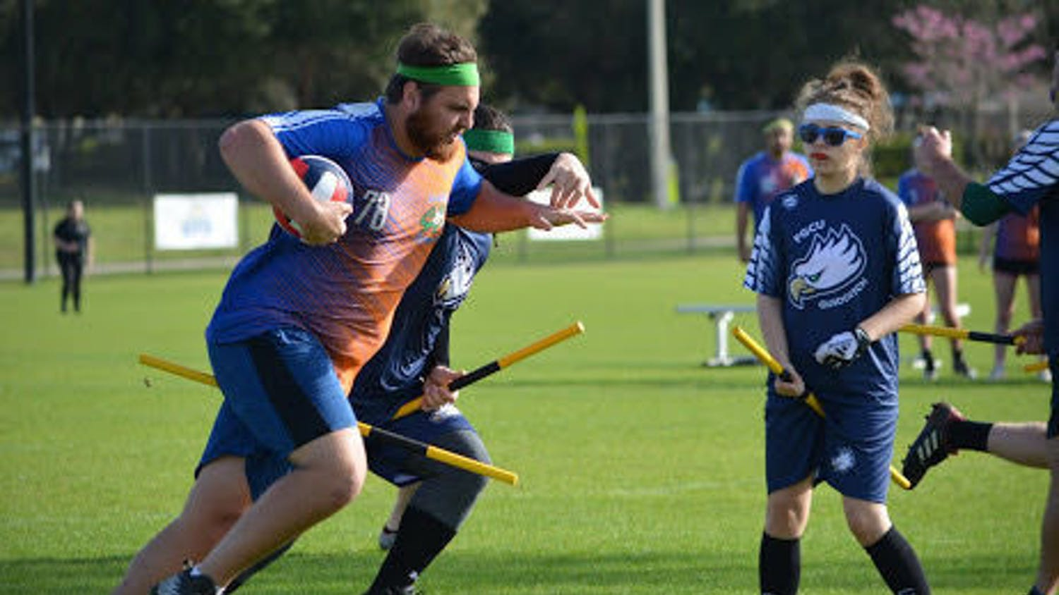 Team captain of the UF Quidditch team Jeremy Kowkabany, a 21-year-old UF astrophysics junior, runs across the field with the ball.