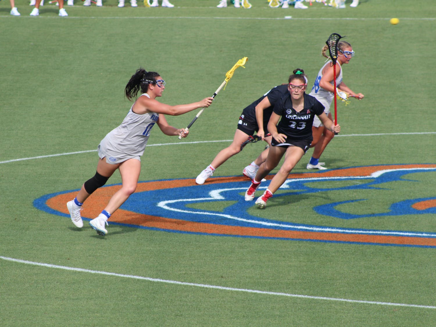 2021 AAC Midfielder of the Year Shannon Kavanagh, pictured in grey, passes down the field against Cincinnati in the conference semifinal on May 6. Kavanagh scored her 200th goal during the game.
