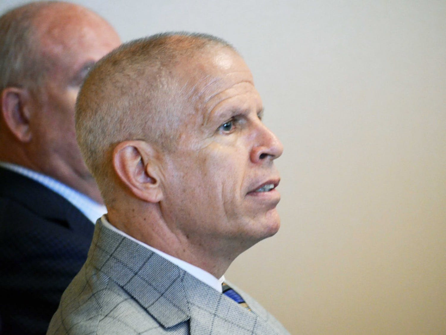 UF athletics director Jeremy Foley listens as Jim McElwain gives his press conference on Dec. 6, 2014, at Ben Hill Griffin Stadium.