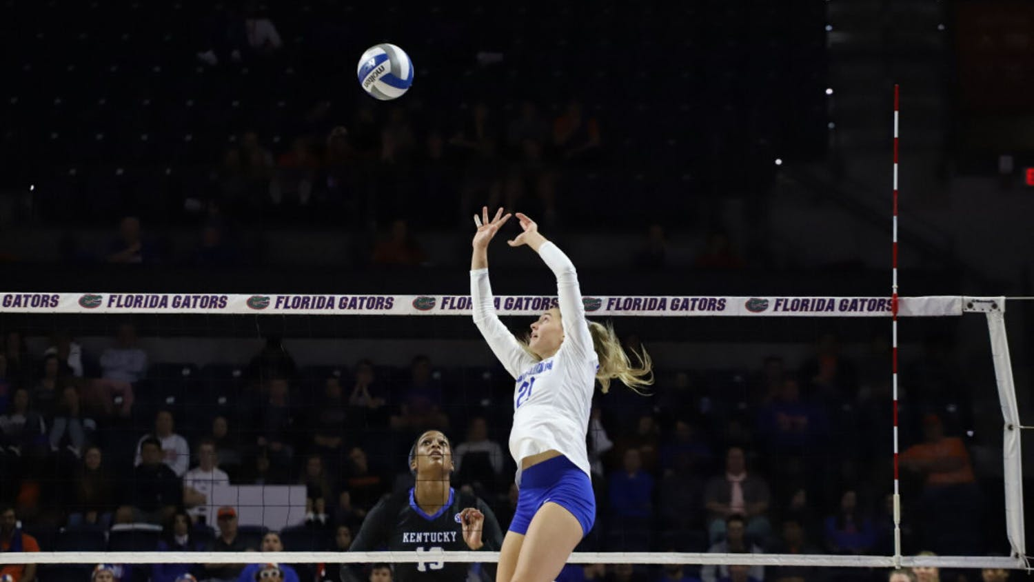 Marlie Monserez sets for the Gators at a 2019 home match versus Kentucky. Monserez totaled 61 assists during Saturday's double-header as Florida began 2021 3-0.