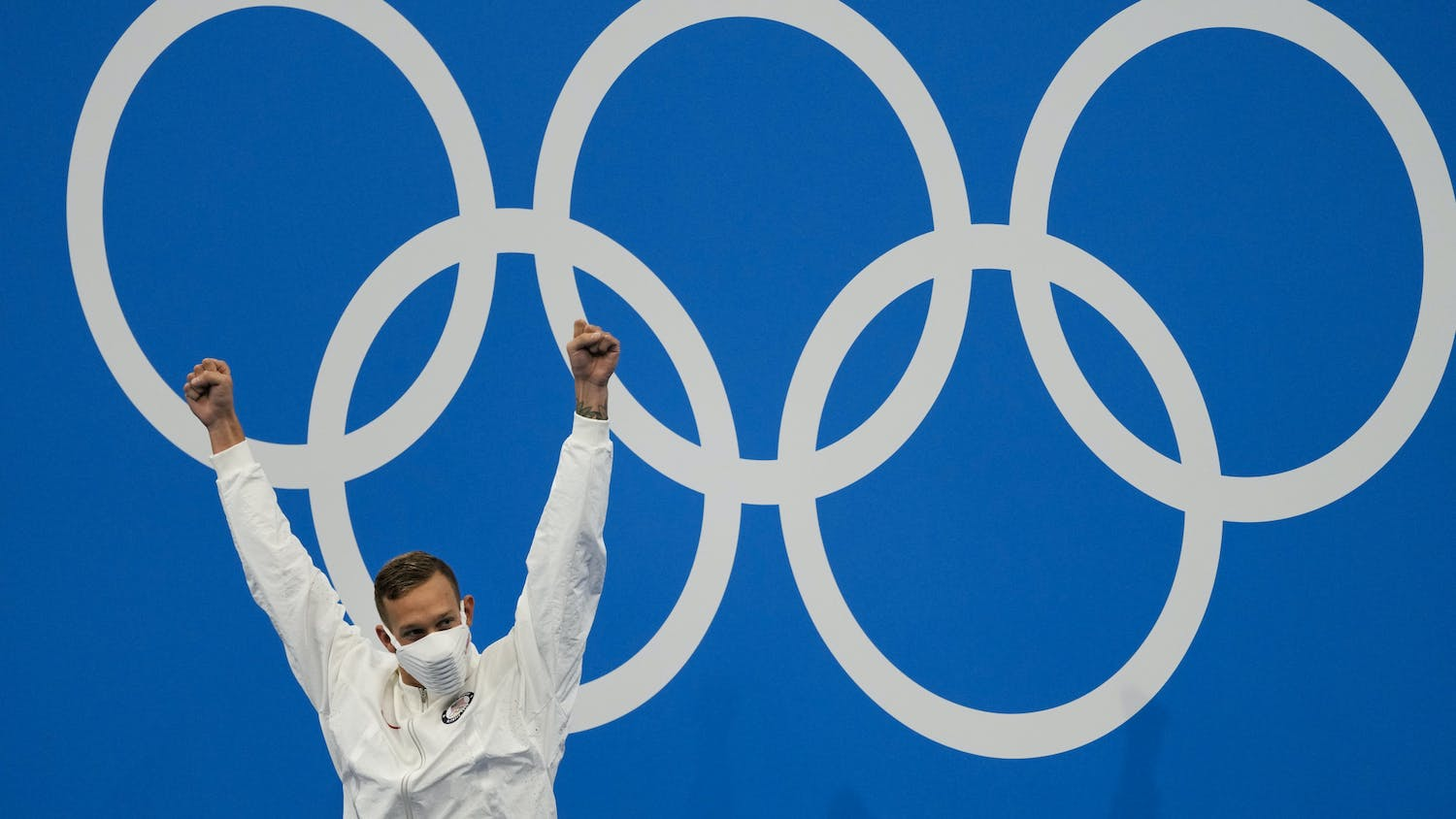 Caeleb Dressel, of the United States, celebrates his gold medal in the men's 4x100-meter medley relay final at the 2020 Summer Olympics, Sunday, Aug. 1, 2021, in Tokyo, Japan. (AP Photo/Jae C. Hong)