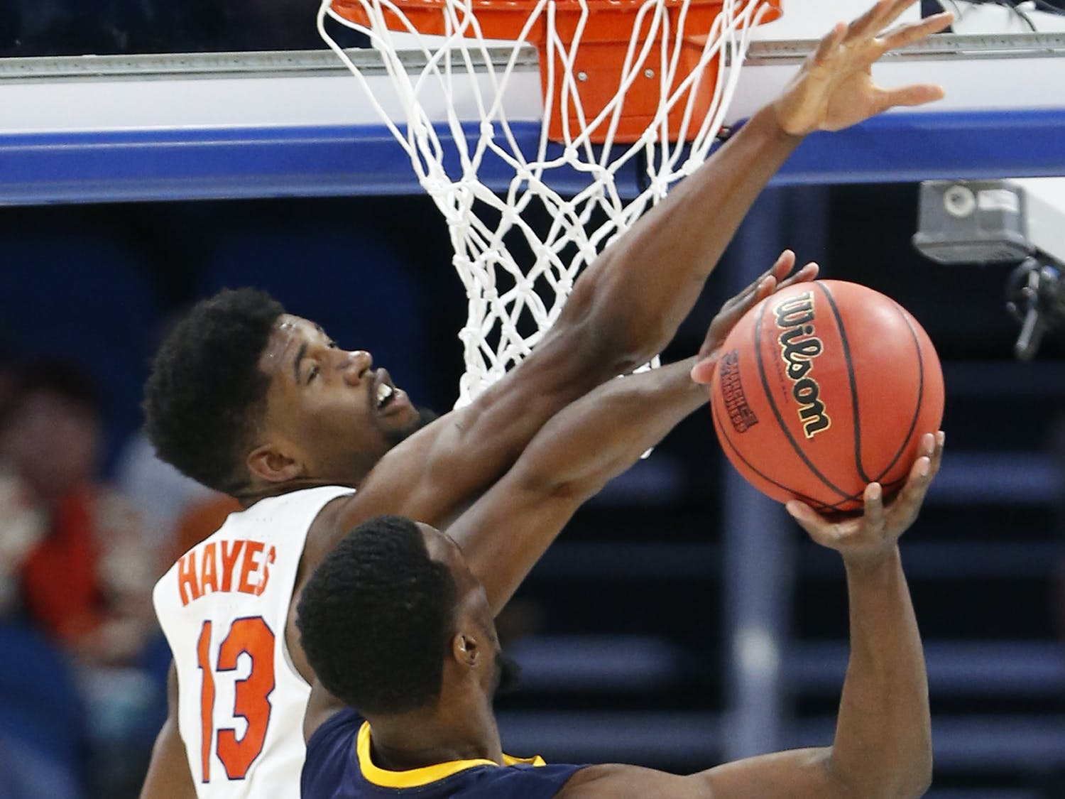 Florida forward Kevarrius Hayes (13) blocks a shot by East Tennessee State forward Tevin Glass (40) during the second half of the first round of the NCAA college basketball tournament, Thursday, March 16, 2017 in Orlando, Fla. Florida defeated ETSU 80-65. (AP Photo/Wilfredo Lee)