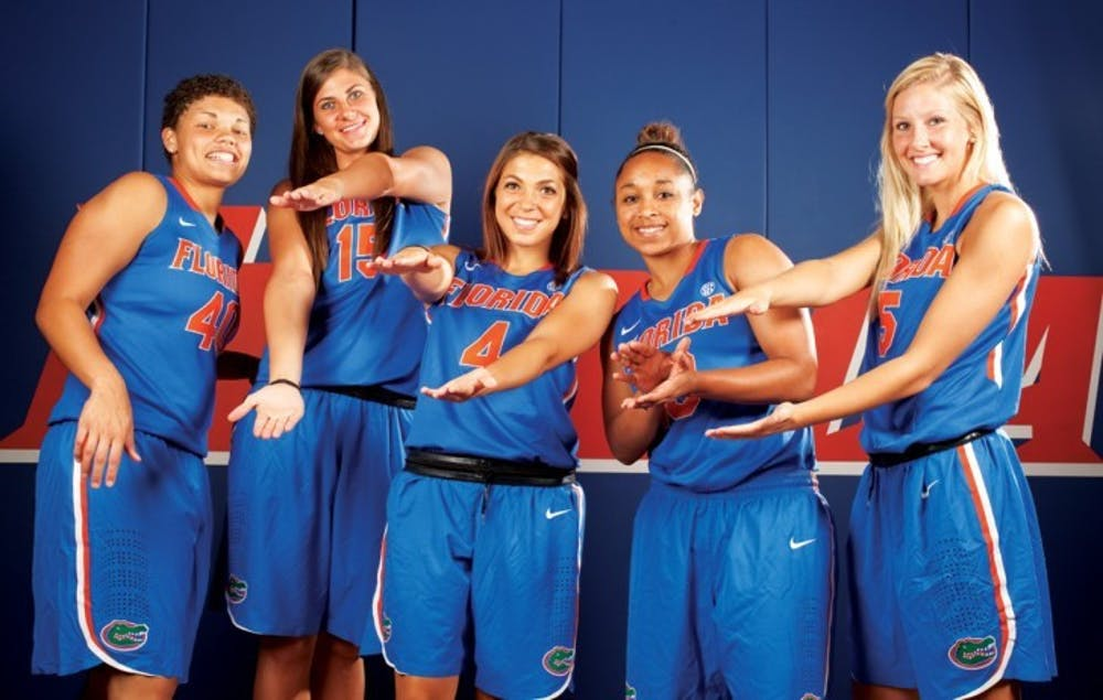 <p>Redshirt freshman Carlie Needles (third from left) poses for a photo with four other freshmen during University of Florida basketball media day on Oct. 10. Needles hit the game-winning three pointer with six seconds left against the N.C. State Wolfpack on Friday night at the South Point Thanksgiving Shootout in Las Vegas.</p>