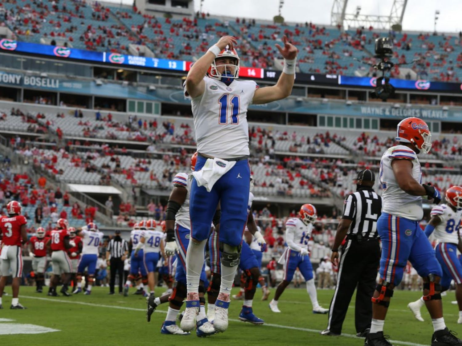 Florida quarterback Kyle Trask hypes up the crowd at TIAA Bank Stadium in Jacksonville, Florida, Saturday. The Gators defeated the Bulldogs in the most recent rivalry game on Nov. 7.