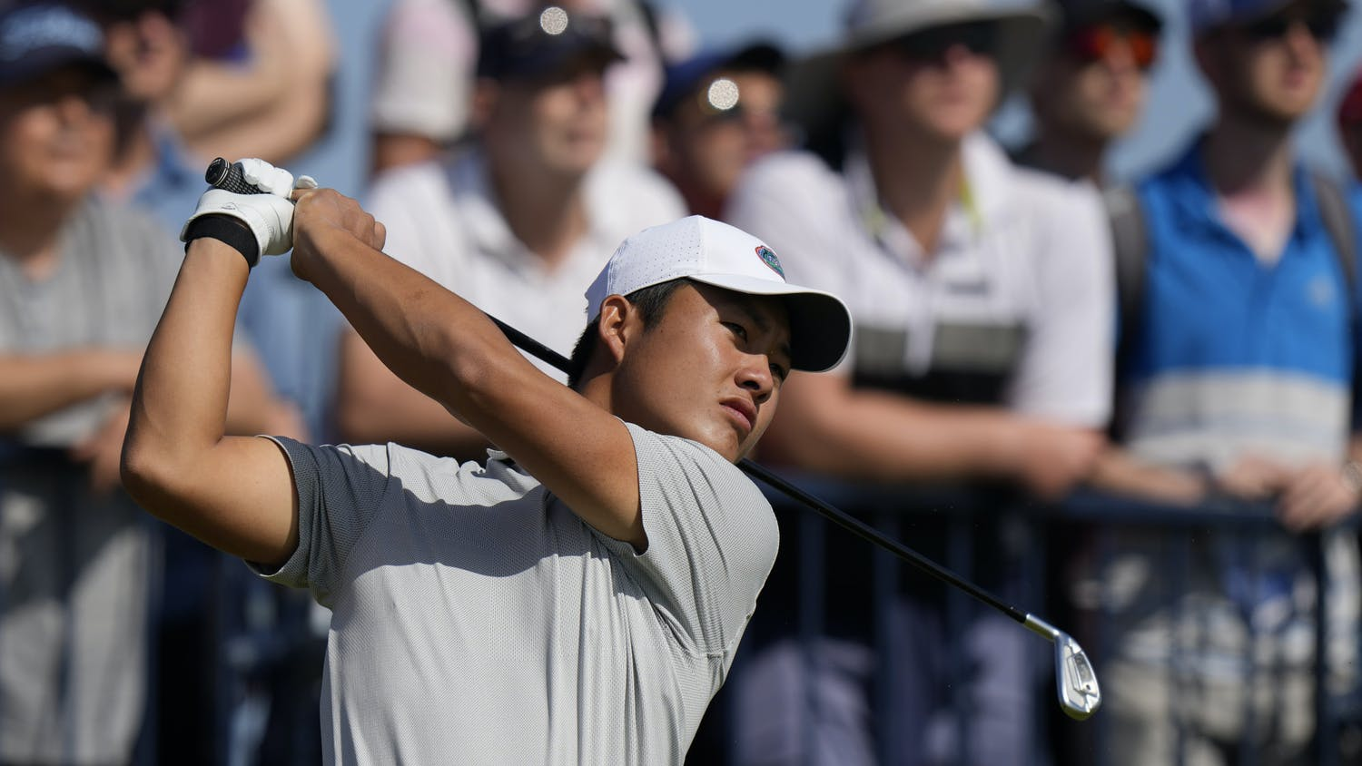 China's Yuxin Lin plays his tee shot on the 3rd hole during the third round of the British Open Golf Championship at Royal St George's golf course Sandwich, England, Saturday, July 17, 2021. (AP Photo/Alastair Grant)