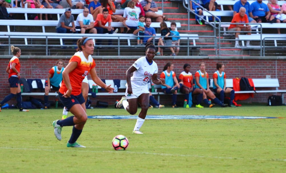 <p>Deanne Rose chases a Syracuse player with possession of the ball during Florida's 2-1 win against the Orange on&nbsp;Aug. 27 at Donald R. Dizney Stadium.</p>