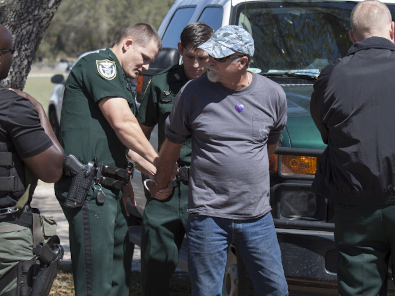 Deputies arrested a man March 4 after he punched a President Donald Trump supporter in the face after an argument outside Countryside Baptist Church. Michael Robert Chriss, 64, punched Charles Duane Webster, 61, as the two joined a crowd of hundreds outside the church, located at 10926 NW 39th Ave. The crowd, primarily protesters, gathered following a town hall meeting with Rep. Ted Yoho in the church. Yoho, a Republican who represents Florida's 3rd Congressional District, which includes Alachua, Clay and Bradford counties and parts of Marion County, answered questions about issues such as Trump's temporary travel ban, health care, LGBTQ+ rights and the alleged ties between the president's administration and Russia. The protesters were not allowed inside the town hall and, instead, chanted and waved signs. - Meryl Kornfield