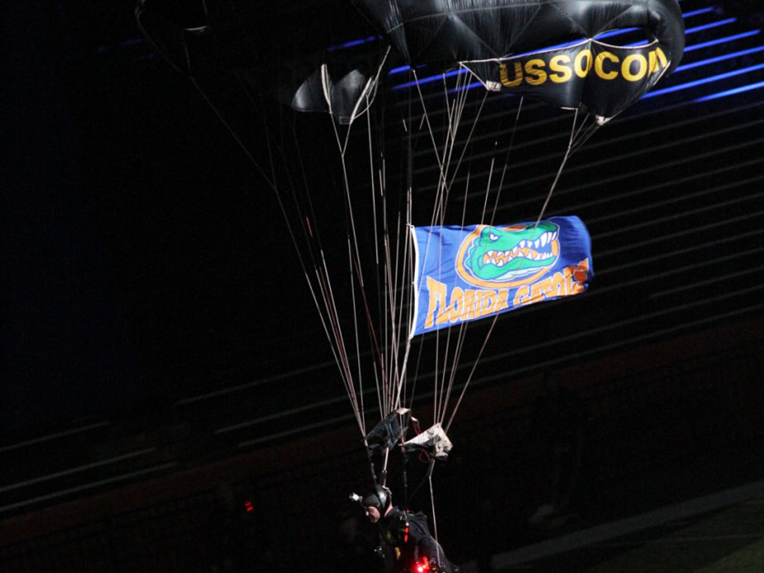 A member of the Para-Commandos skydiving team lands on Florida Field at Ben Hill Griffin Stadium during Gator Growl on Friday night.