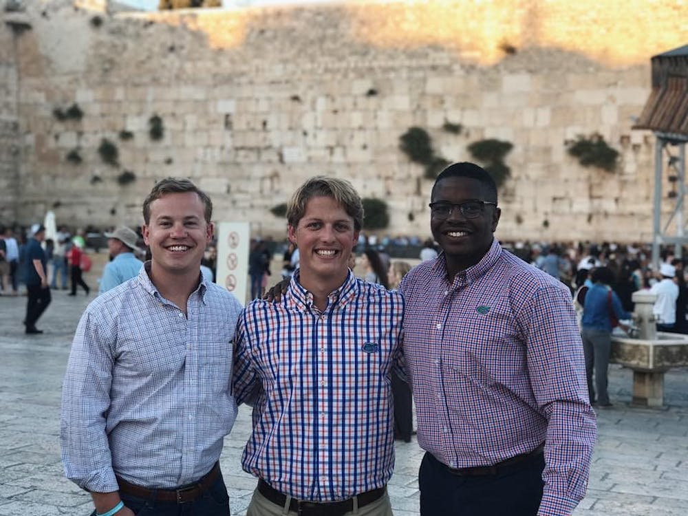 <p><span>Michael Murphy stands with 2017-2018 UF Student Government President Smith Meyers and 2016-2017 SG Vice President Brendon Jonassaint at the Western Wall in Israel.&nbsp;</span></p>