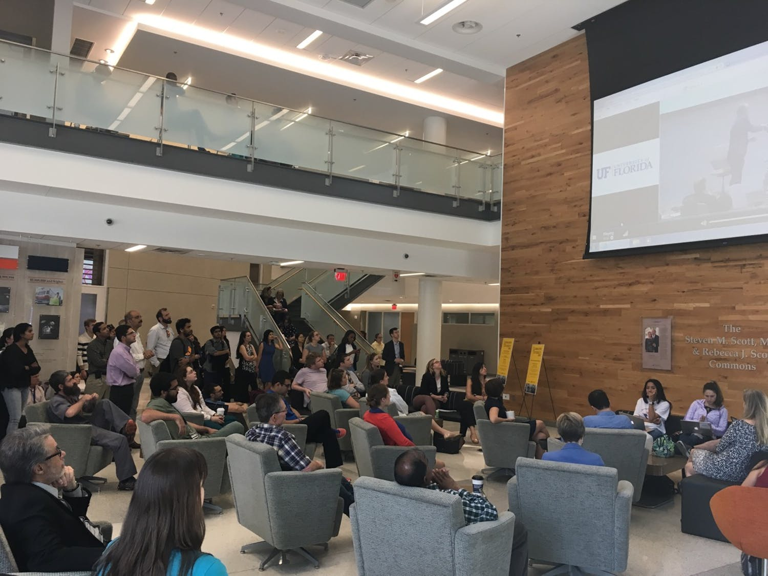 About 250 people watch a livestream of National Institutes of Health Director Dr. Francis Collins speak to UF students and faculty in the North Learning Studies Room of the Harrell Medical Education Building Monday morning. Collins spoke about the importance of funding STEM research.