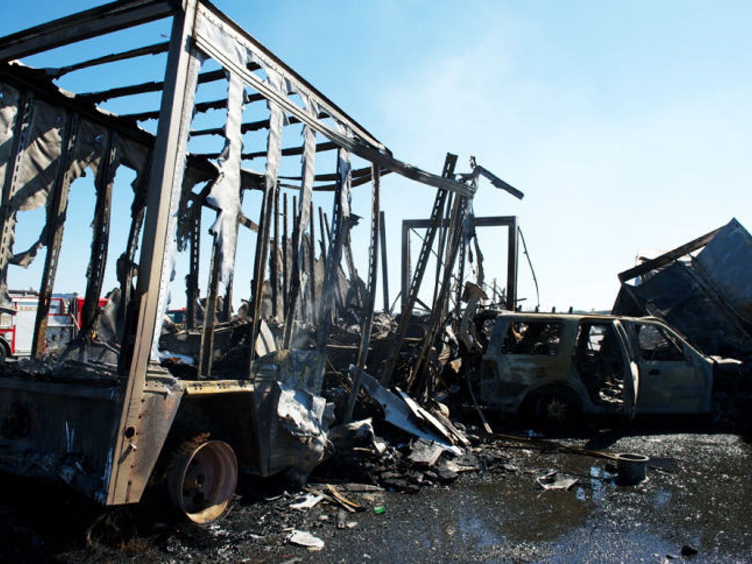 The charred wreckage of a semitrailer and an SUV sit on Interstate 75 in Paynes Prairie Preserve State Park on Jan. 29, 2012. Today marks the one-year anniversary of the accident that claimed the lives of 11.