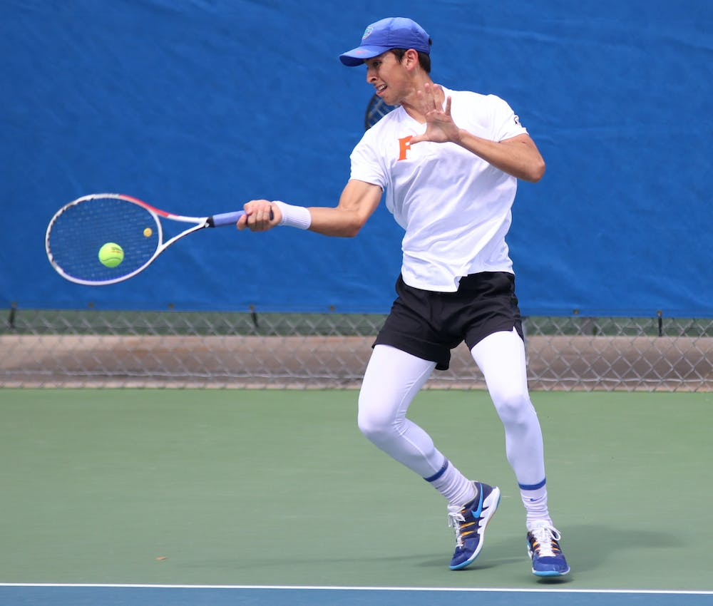 Florida's Andy Andrade returns a ball against Auburn on February 21. Andrade and the Gators face Illinois Monday with a spot in the national quarterfinals on the line.