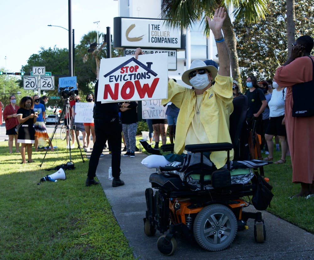 <p>Hugh E. Suggs, 62, a Gainesville homeowner and author, protests outside of The Collier Company office in downtown Gainesville on Monday, May 3, 2021. Suggs was joined by about 25 other people protesting their landlords&#x27; tendency to prioritize higher paying tenants and ignore the needs of lower income families.</p>