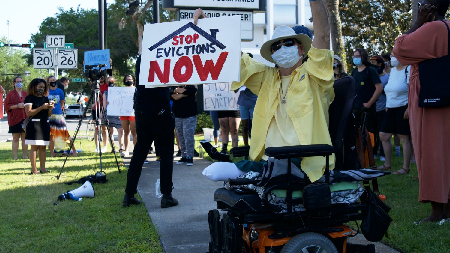 Hugh E. Suggs, 62, a Gainesville homeowner and author, protests outside of The Collier Company office in downtown Gainesville on Monday, May 3, 2021. Suggs was joined by about 25 other people protesting their landlords' tendency to prioritize higher paying tenants and ignore the needs of lower income families.