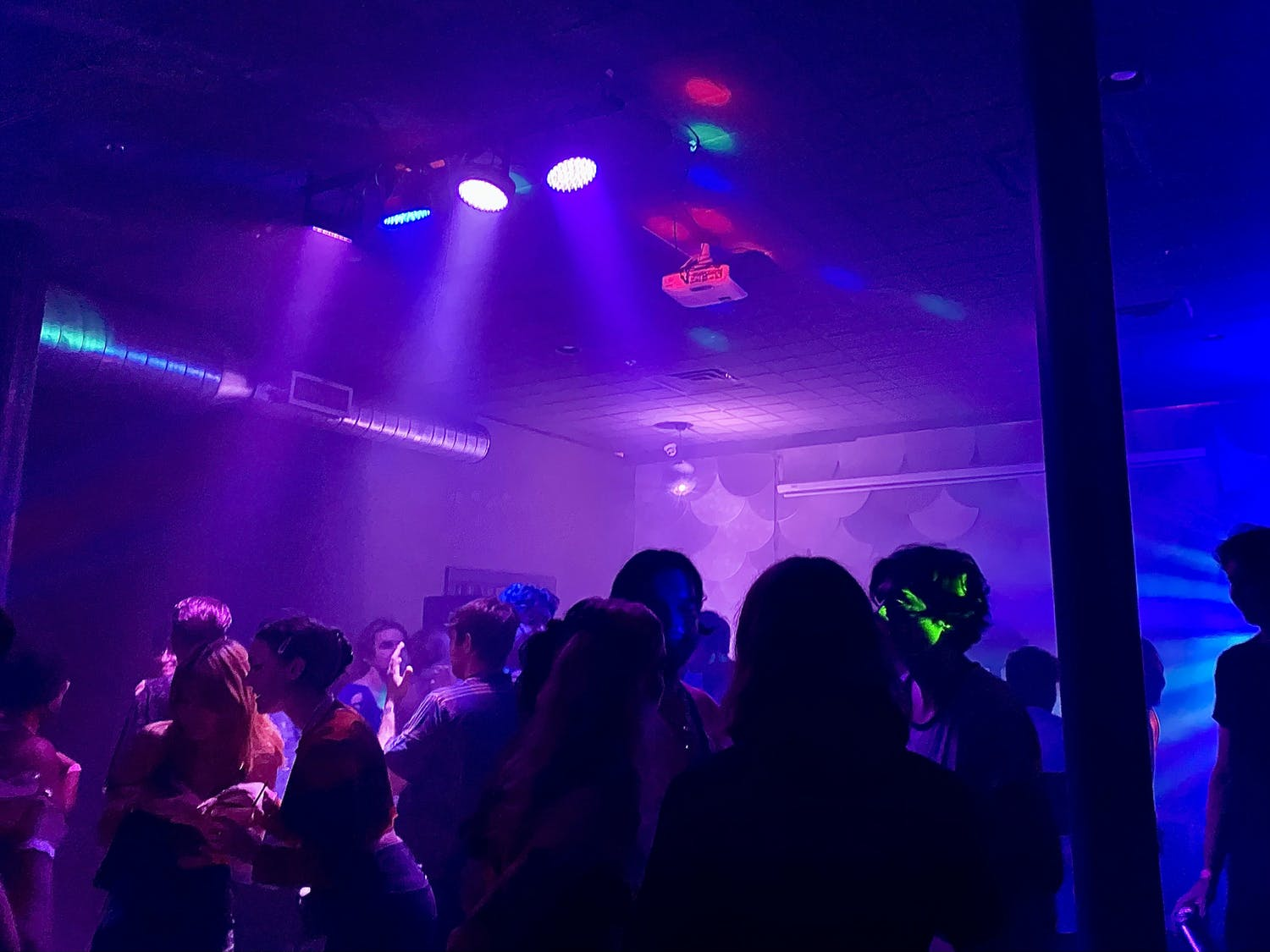 Patrons gather on the strobe-lit dance floor during The Wooly's SOPHIE tribute, held Oct. 15.