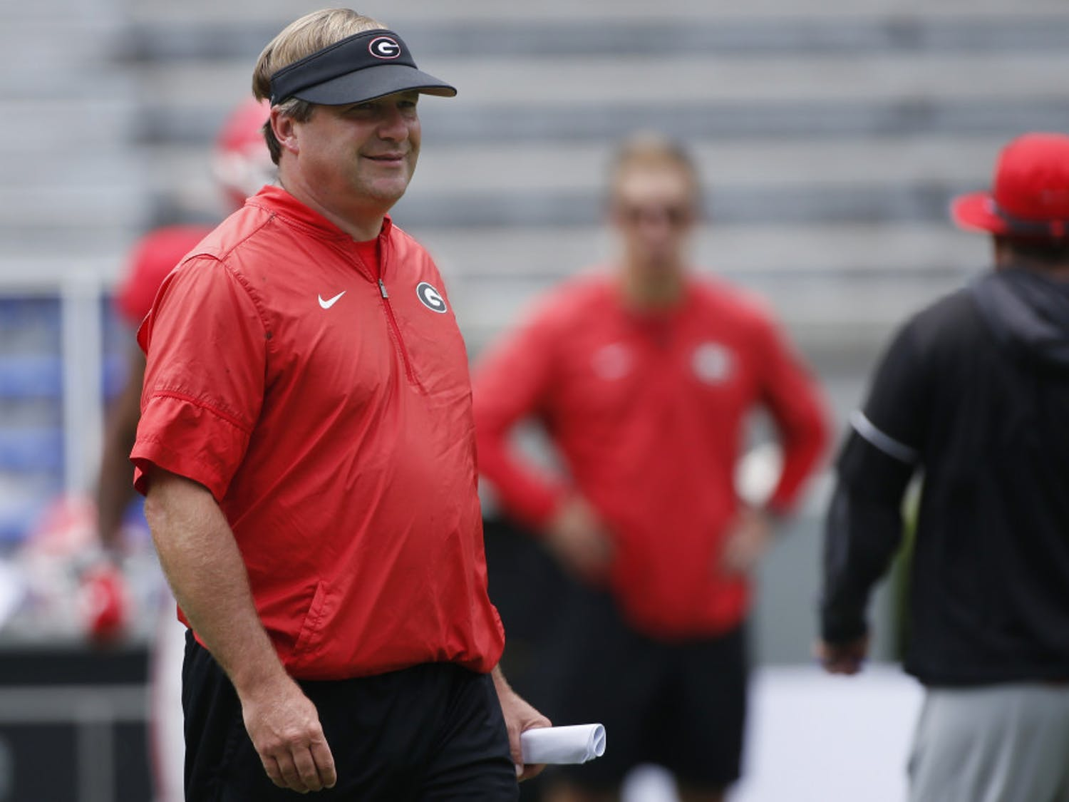 Georgia coach Kirby Smart looks on during an NCAA college football practice at Sanford Stadium in Athens, Ga., Saturday, Aug. 10, 2019.