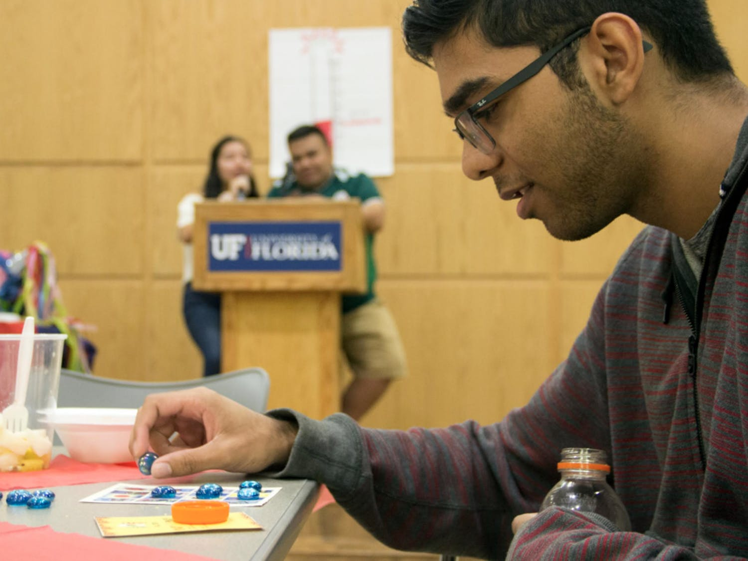 Garrick Sewsankar, an 18-year-old computer science freshman, plays Noche de Lotería on Monday, October 15, during a fundraiser held by the Mexican-American Student Association. Similar to Bingo, Sewsankar was one space away from winning the round. Donations from the fundraiser are going to help immigrants receive free legal services.