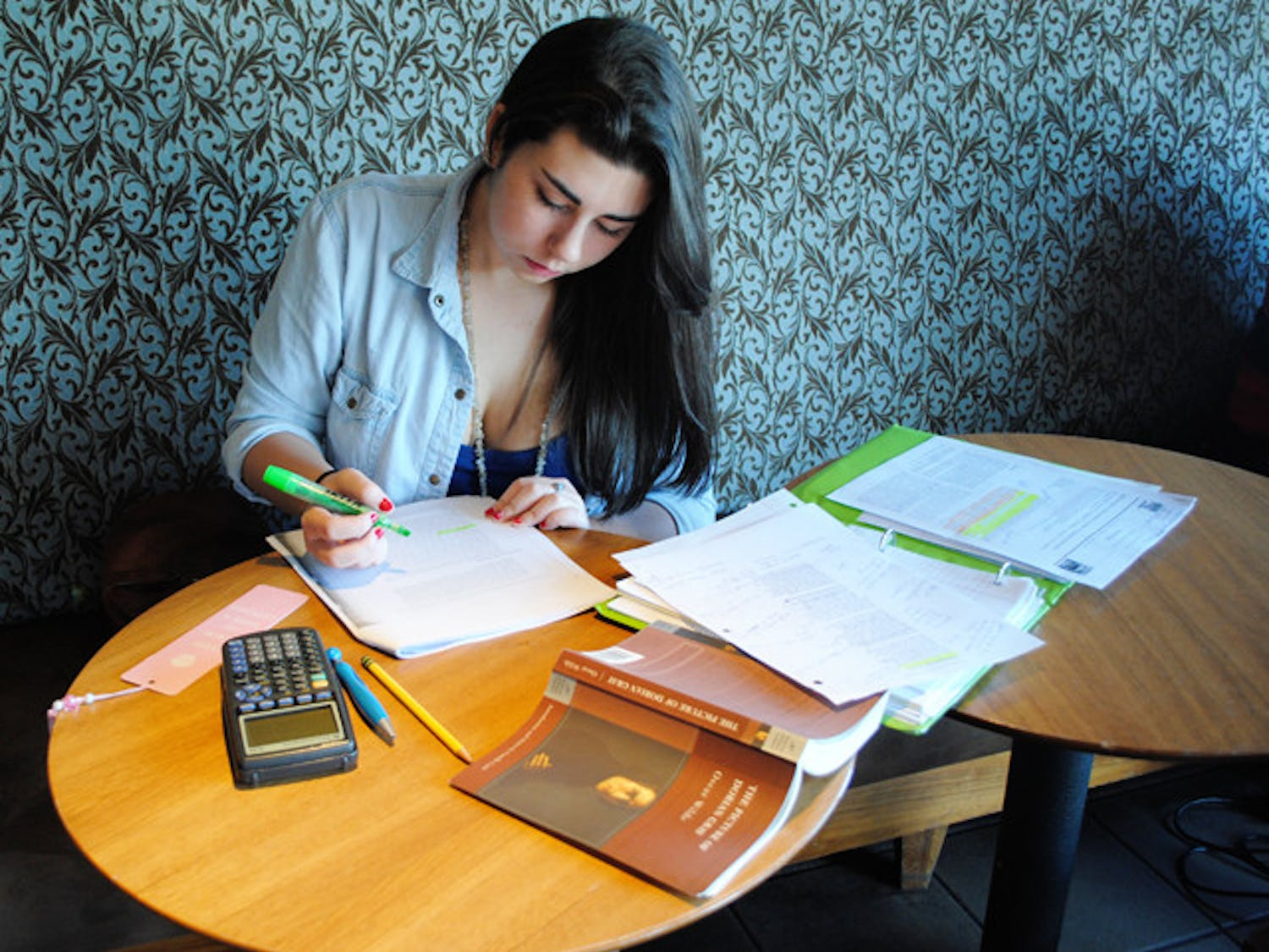 Marisol Diaz, 17, a student at South Dade Senior High School, studies and does homework for her International Baccalaureate program classes.