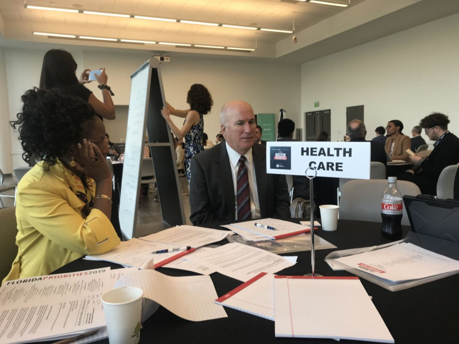 Former Executive Director of We Care Manatee Victoria Kasdan (left) and group CEO of Florida Medical Center and Tenet Health Miami-Dade Group Jeffrey Welch (right) discuss ways Florida can improve its healthcare system during the Florida Priorities Summit.