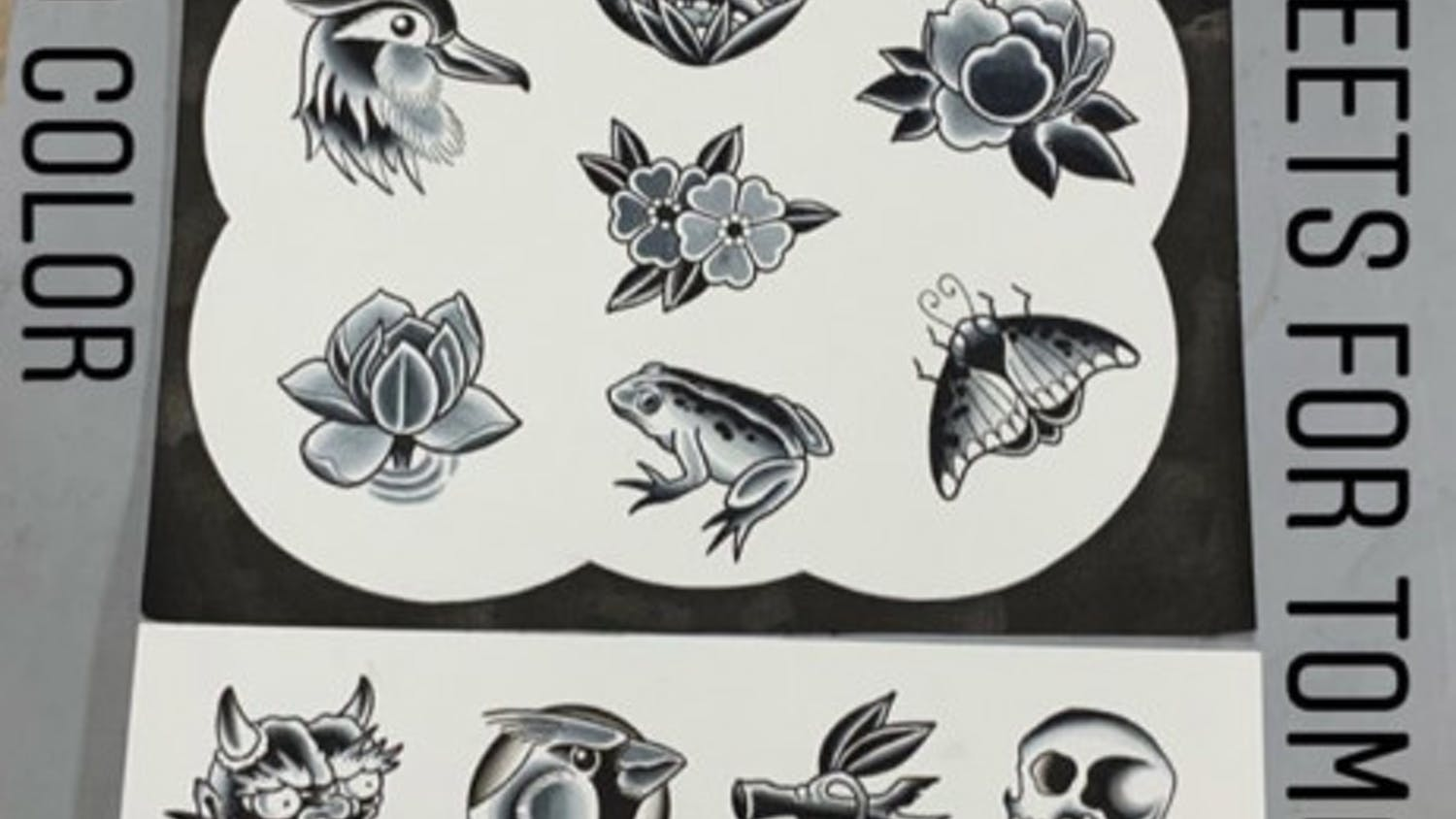 Tattoo artist Tim Strating displays his flash sheets for Anthem Tattoo's Friday the 13th event.