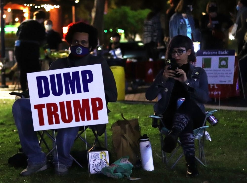 A picture of people watching election results at Bo Diddley Plaza