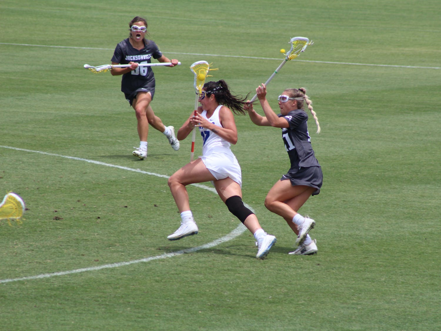 AAC Midfielder of the Year Shannon Kavanagh runs through the Jacksonville defense on May 16. Kavanagh and the Gators face Syracuse for a trip to the Final Four Saturday.