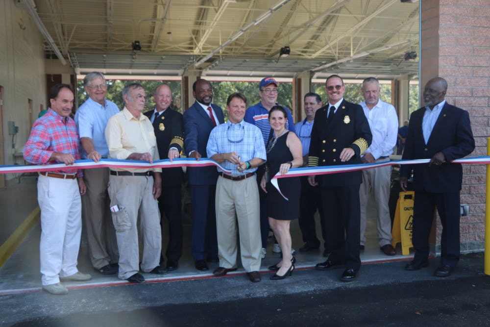 """<p dir=""""ltr"""">Alachua County Commissioner Ken Cornell cuts the ribbon in front of the new Fire Rescue Station 33, located at 5901 NW 34th Blvd., on Friday. The station will house six ambulances.</p>"""