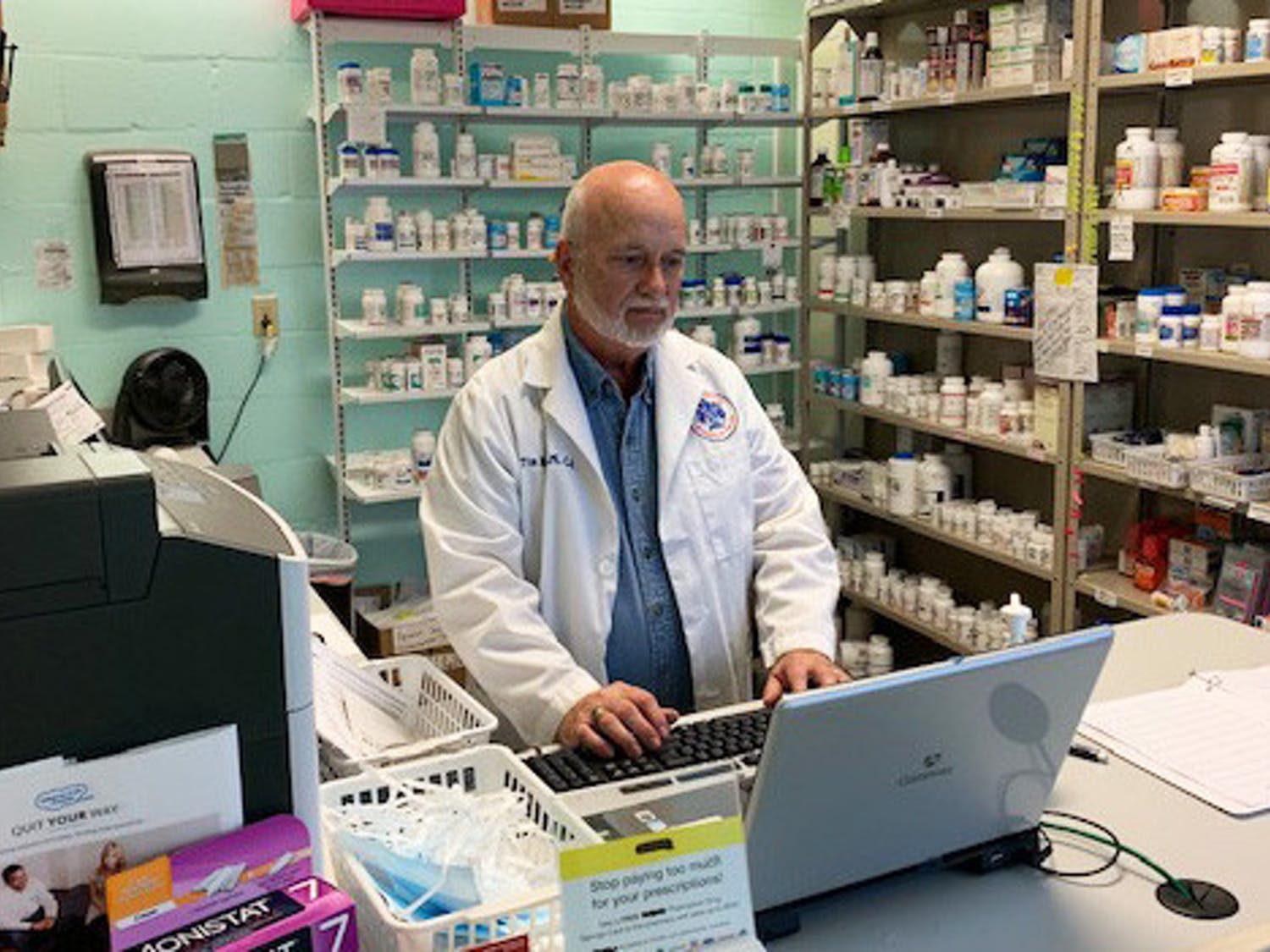 Tim Rogers looks at a computer inside the Grace Pharmacy (Photo courtesy of Lorry Davis, programs administrator for Grace Healthcare Services)