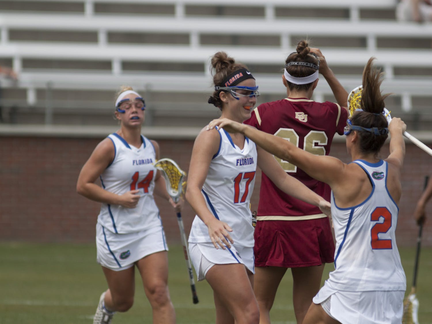 Mollie Stevens (17) and Sammi Burgess (2) embrace during Florida's 15-8 win against Denver on March 25, 2017, at Donald R. Dizney Stadium.