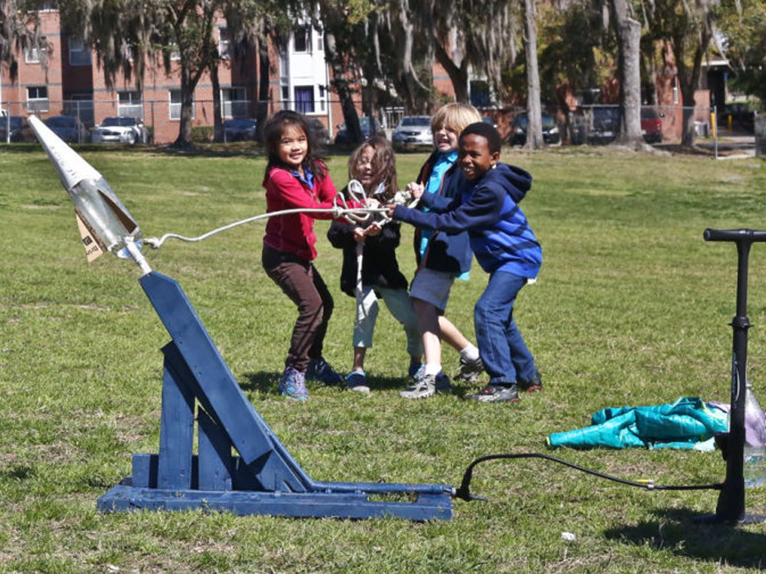 Second and third graders from Idylwild Elementary School launch bottle rockets on Flavet Field on Thursday morning. The American Institute of Aeronautics and Astronautics at UF assisted the students in building the rockets and launching them for the field trip.