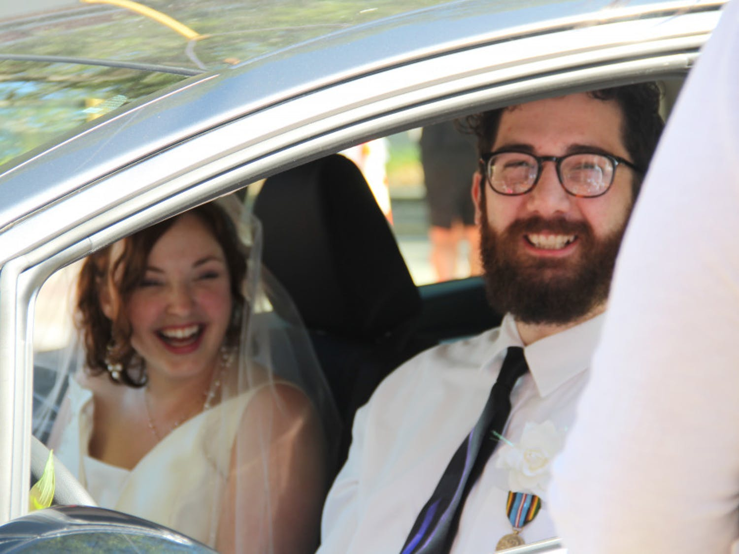 """Decked in veils, flowers and formal wear, couples from across Florida drove cars, trucks and limousines to the drive-thru-turned-""""Wedding Window."""" They pronounced their love to each other at the Alachua County Family and Civil Courthouse from about 5 to 11 p.m. Thursday. Read more here."""