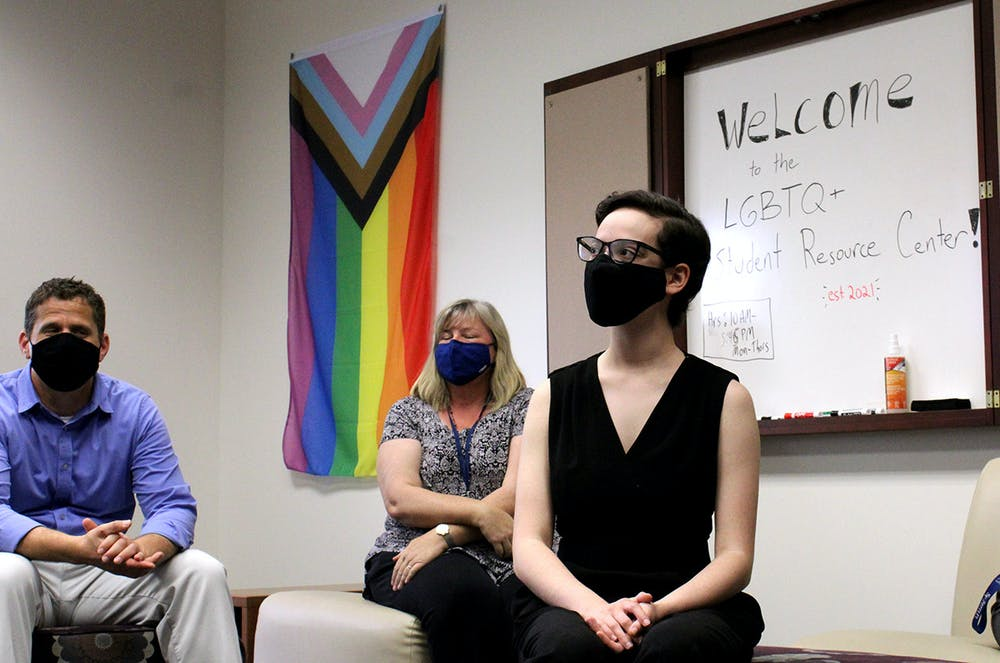 <p>Elisabeth Eder (right), 21, a Santa Fe sociology sophomore, sits at the grand opening for the college&#x27;s LGBTQ resource center on Monday, March 29, 2021. Eder started a petition to open the center last February.</p>